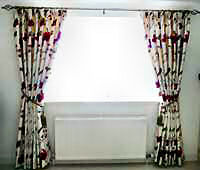 Embroidered silk interlined curtains on metal pole.