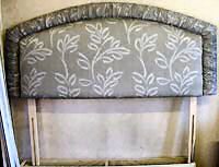 Curved headboard with ruching detail.