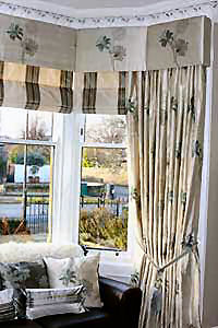 Silk interlined curtains with blinds and padded pelmet to match.