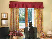 Patterned curtains and tie backs with matching gathered valance.